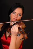Young beautiful sexy woman with violin. Glamour portrait of young beautiful sexy woman with violin and drums Royalty Free Stock Photo