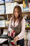 Young beautiful shop assistant Stock Photos