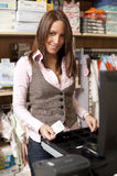 Young beautiful shop assistant Stock Photography