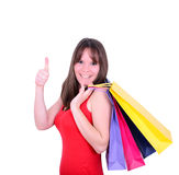 Young beautiful shopping woman on sale holding many colorful sho Royalty Free Stock Image