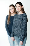 Young and beautiful sisters in friendship, sharing joy, trust, l Royalty Free Stock Photos