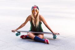 Young beautiful skater woman in the street Stock Photo