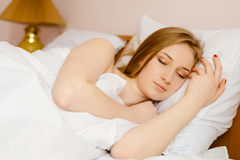 Young beautiful sleeping blonde lady lying in bed Stock Photo