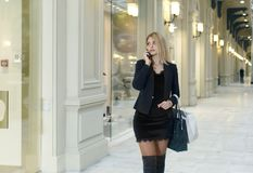 Young beautiful slender girl walks about shop Royalty Free Stock Photos