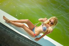Young beautiful slim sexy girl in bikini and pareo is resting on cruise on a private sailing yacht. Young beautiful slim sexy girl in bikini is resting on a royalty free stock images