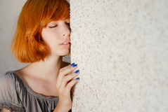 Young beautiful slim woman standing near wall Royalty Free Stock Image