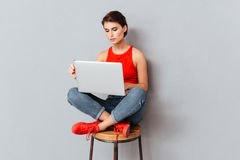 Young beautiful smart girl using laptop pc computer for study Stock Photos