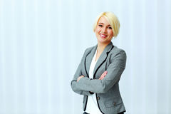 Young beautiful smiling businesswoman with arms folded Stock Photography