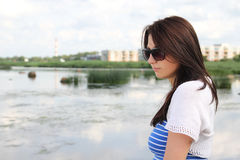 Young beautiful smiling female near the lake Royalty Free Stock Photo
