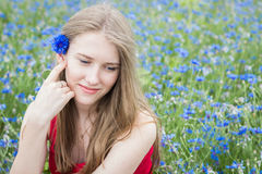 Young beautiful smiling girl with flowers in her hair Stock Photography