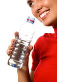Young beautiful smiling girl with mineral water. (isolated on white royalty free stock image