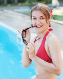 Young beautiful smiling girl near swimming pool. Royalty Free Stock Photo