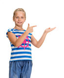 Young beautiful smiling girl with pointing hand Royalty Free Stock Photography