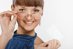 Young beautiful Smiling girl shows a business card Royalty Free Stock Image