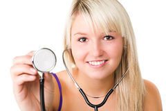 Young beautiful smiling girl with stethoscope stock photography