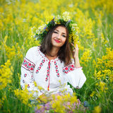 Young beautiful smiling girl in Ukrainian costume with a wreath Royalty Free Stock Images