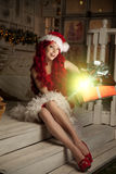 Young beautiful smiling santa woman. Christmas Fashionable luxur Royalty Free Stock Photography