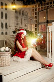 Young beautiful smiling santa woman. Christmas Fashionable luxur Royalty Free Stock Images