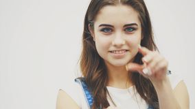 Young beautiful smiling sexy flirting girl moving her hands like a cat or panther, winking at the camera and giving. Closeup, 4K video of seductive isolated girl stock footage