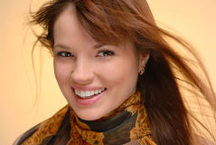 Young beautiful smiling woman in autumn scarf Royalty Free Stock Photos