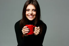 Young beautiful smiling woman with cup of coffee Royalty Free Stock Photo