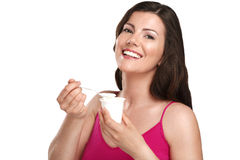 Young beautiful smiling woman eating fresh yogurt. On white Royalty Free Stock Images