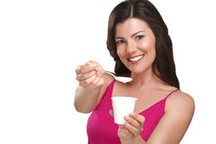 Young beautiful smiling woman eating fresh yogurt Stock Photo