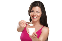 Young beautiful smiling woman eating fresh yogurt. On white Stock Image