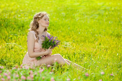 Young beautiful smiling woman in the field, on the grass. Girl r Stock Photo