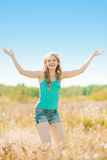Young beautiful smiling woman in the field, on the grass. Girl r Stock Images