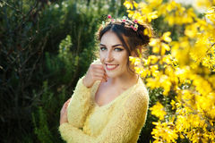 Young beautiful smiling woman in flower headband on head. Woman smiling at the park. Sunset light Stock Image