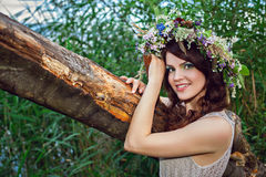 Young beautiful smiling woman with flower wreath Royalty Free Stock Photos