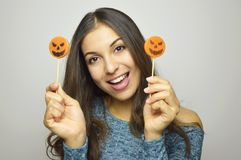 Young beautiful smiling woman with halloween lollipops. Studio picture isolated on gray background. stock photos