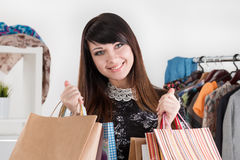 Young beautiful smiling woman holding paper bags Royalty Free Stock Photography