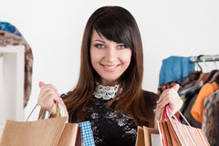 Young beautiful smiling woman holding paper bags Royalty Free Stock Image