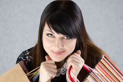 Young beautiful smiling woman holding paper bags Stock Images