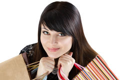 Young beautiful smiling woman holding paper bags with purchases Royalty Free Stock Image