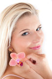 Young beautiful smiling woman holding pink orchid Royalty Free Stock Photos