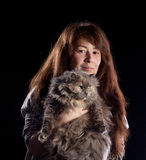 Young beautiful smiling woman holds fluffy cat Stock Photos