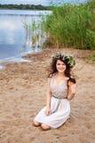 Young beautiful smiling woman at the lake shore Stock Photos