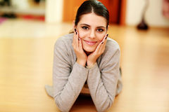 Young beautiful smiling woman lying on the floor Royalty Free Stock Photography