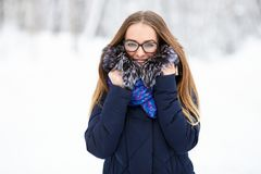 Young beautiful smiling young woman model strolling in wintertime outdoor. Winter fun concept. Royalty Free Stock Photos