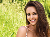 Young beautiful smiling woman outdoors Stock Image