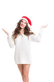 Young beautiful smiling woman in santa hat and white sweater. Royalty Free Stock Images