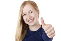 Young beautiful smiling woman shows thumb up Royalty Free Stock Photos