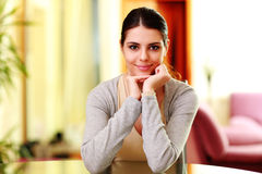 Young beautiful smiling woman sitting at the table Stock Images