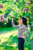 Young beautiful smiling woman smells small bouquet Stock Images