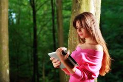 Young beautiful smiling woman with tablet pc Royalty Free Stock Photography