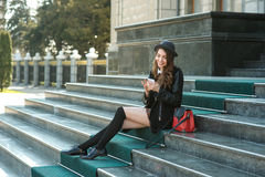 Young beautiful smiling woman talking on cell phone Stock Photos