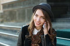 Young beautiful smiling woman talking on cell phone Royalty Free Stock Images